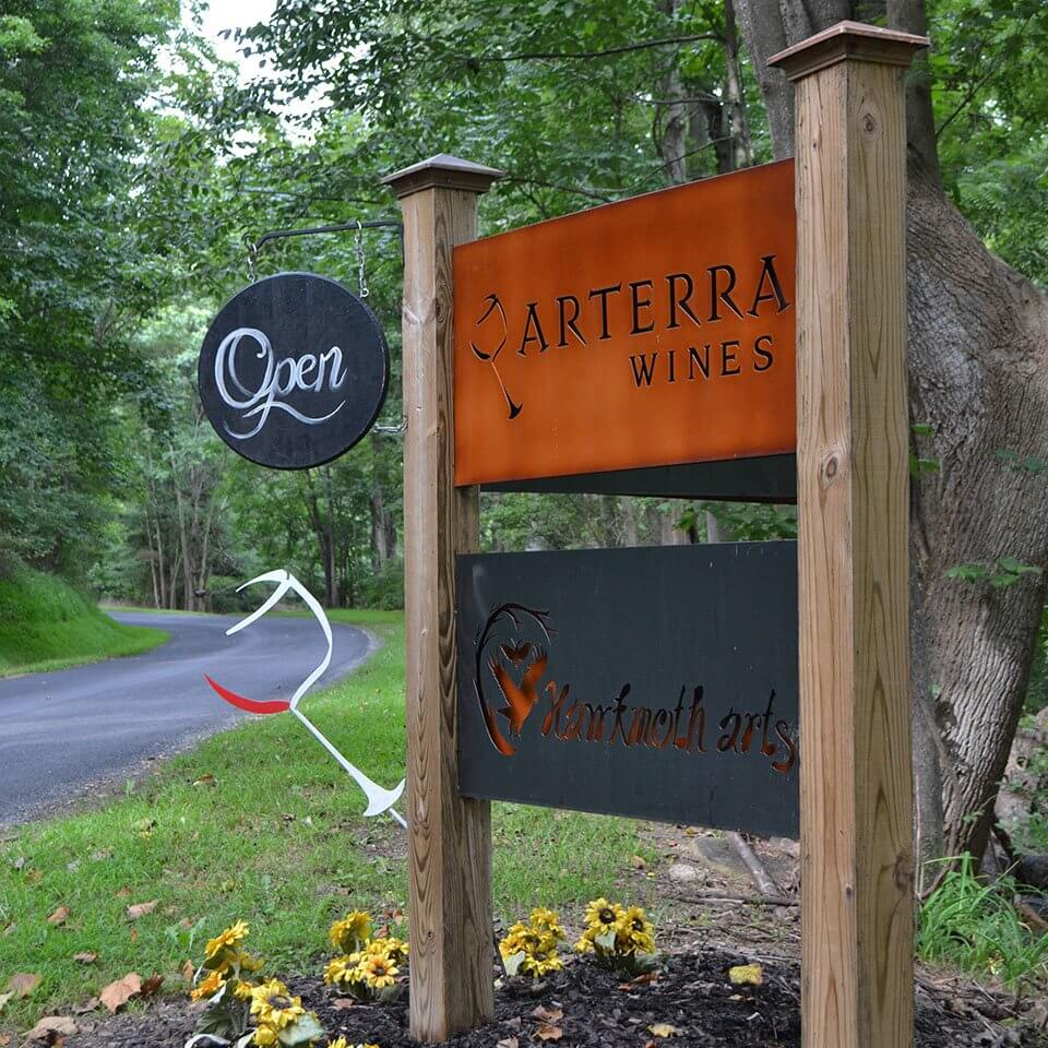 Visiting Arterra Wines, Welcome, Visit, sign located at the entrance of the drive